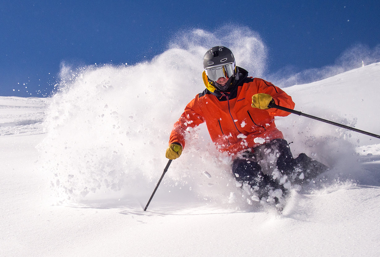 A skier goes down a run while wearing a pair of goggles from Glade Optics.