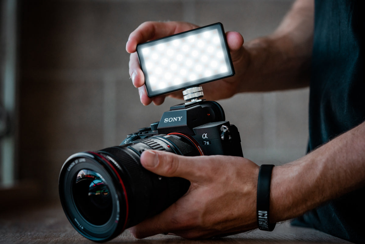 A sony digital SLR with a lights attachment from Lume Cube.