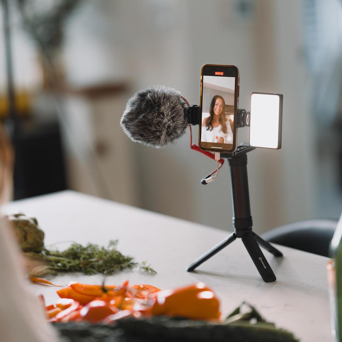 A smartphone on a tripod with lights attachment from Lume Cube.