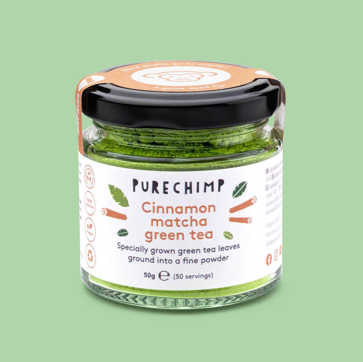 A jar of cinnamon flavoured matcha by PureChimp against a green background.