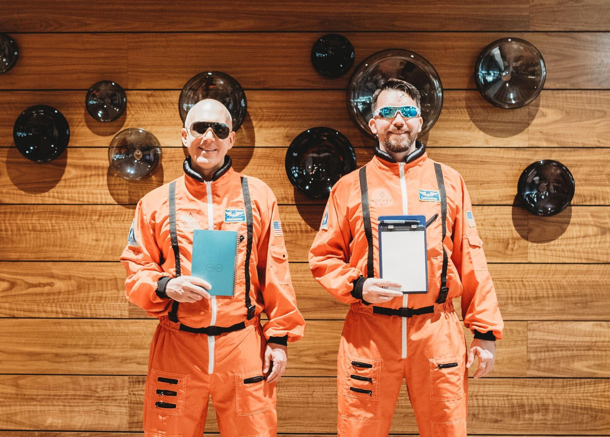 Joe Lamey and Jake Epstein in their astronaut suits and Rockebooks.