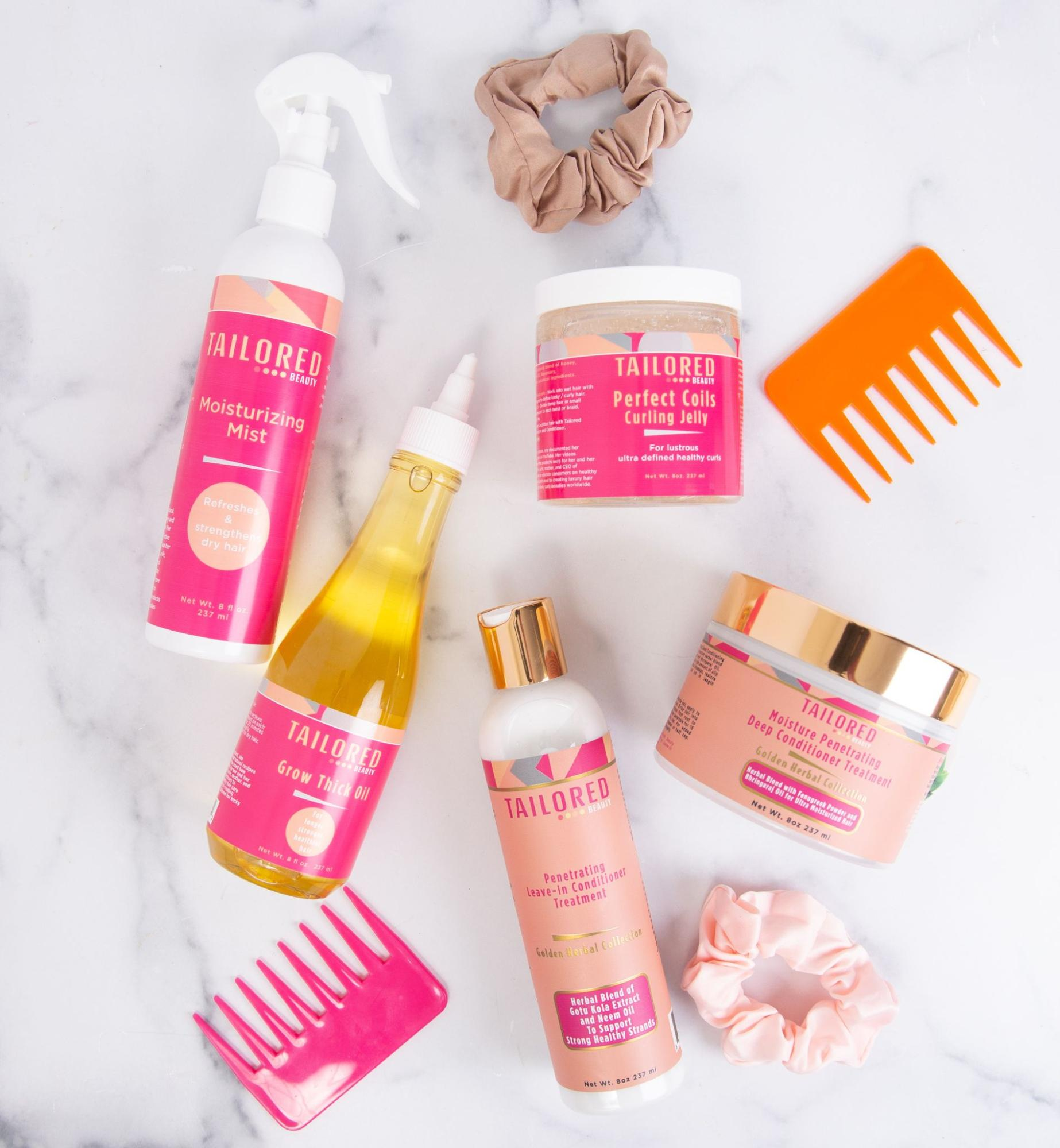 A flat lay of products by Tailored Beauty along with combs and scrunchies.