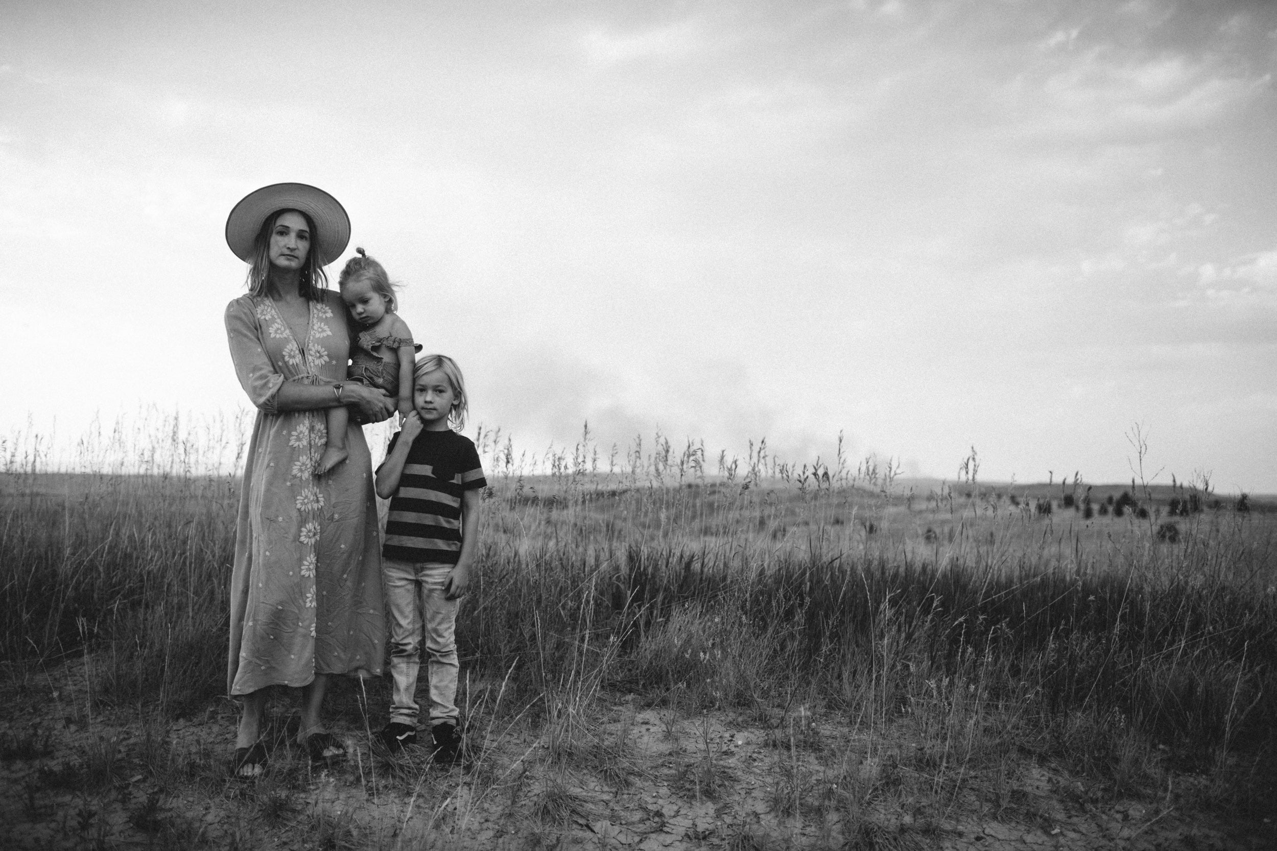 Portrait of Ashley Jennett standing in a field with her children