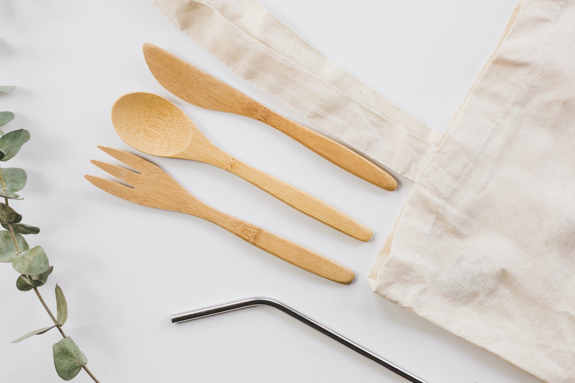 A white label tote bag and bamboo cutlery