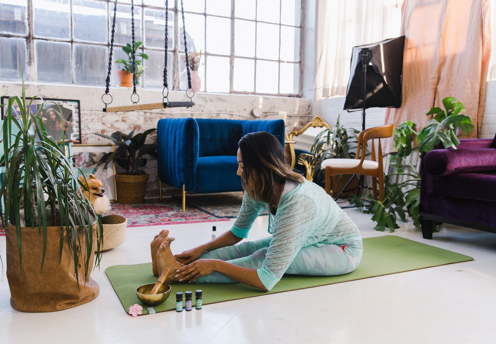 A woman practices yoga in a loft apartment