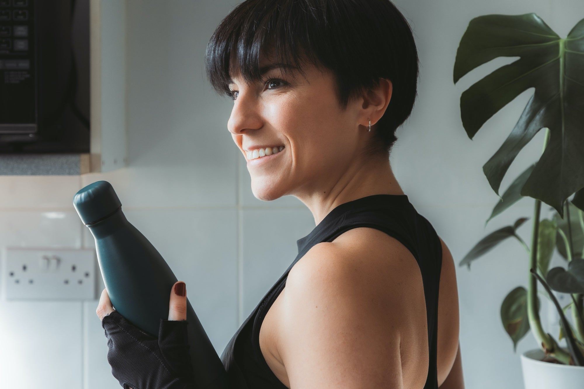 Woman holds a black water bottle