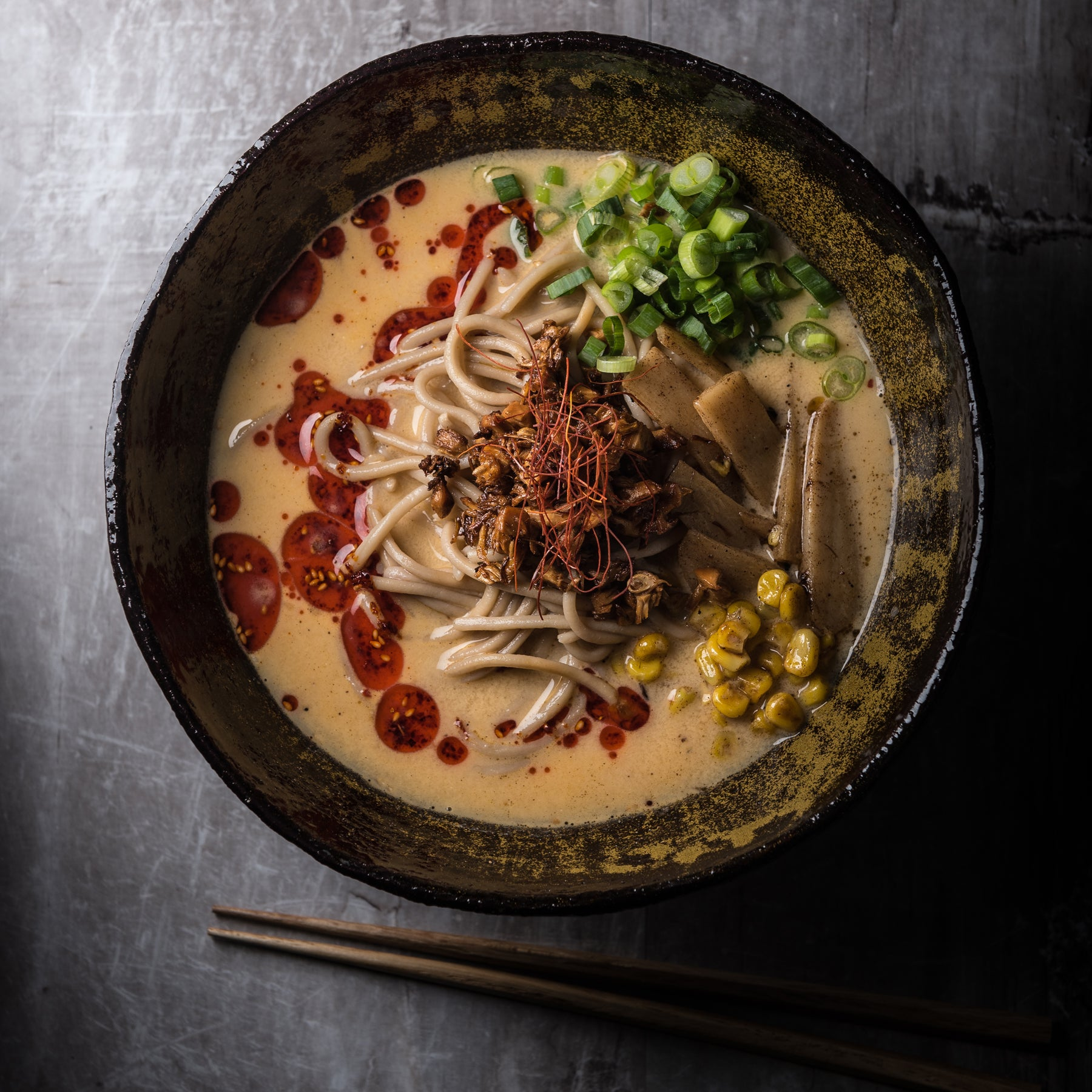 A bowl of vegan ramen, shot from above on a table