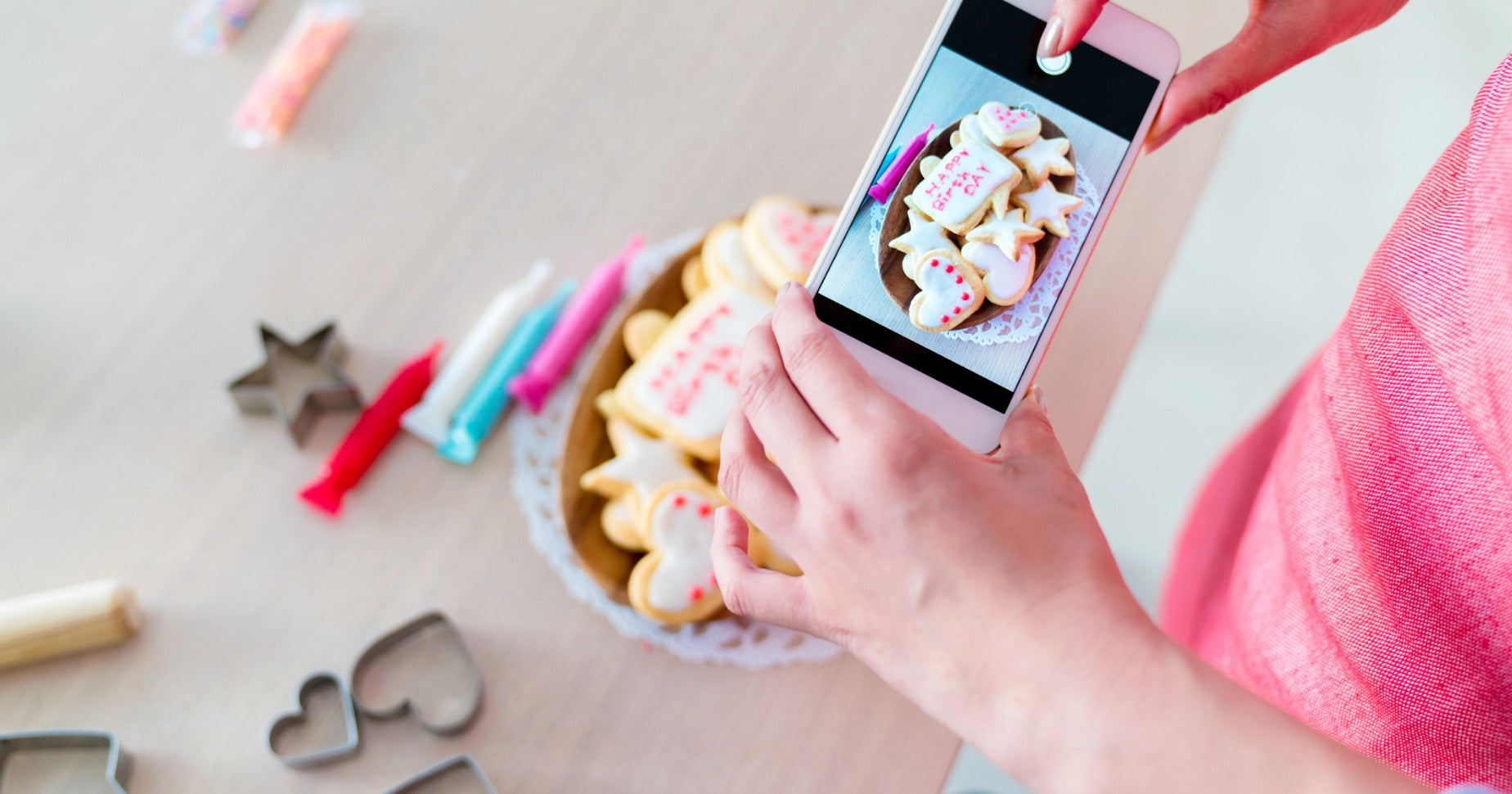 Woman taking product photos with smartphone