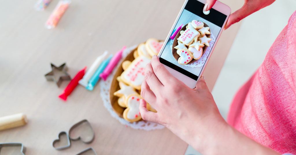 Woman taking product photos on smartphone