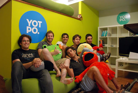 The Yotpo team, all gathered on a couch in their office