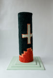 Green with white crosses and a red design along the bottom cat scratcher