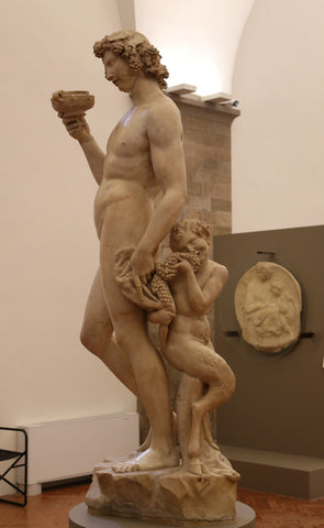 Marble sculpture of Bacchus made by Michelangelo during the renaissance.