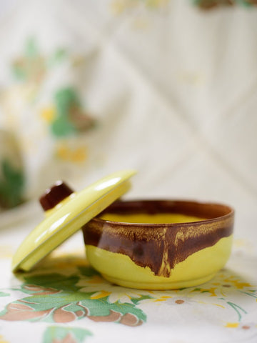 Yellow and brown lidded ceramic dish