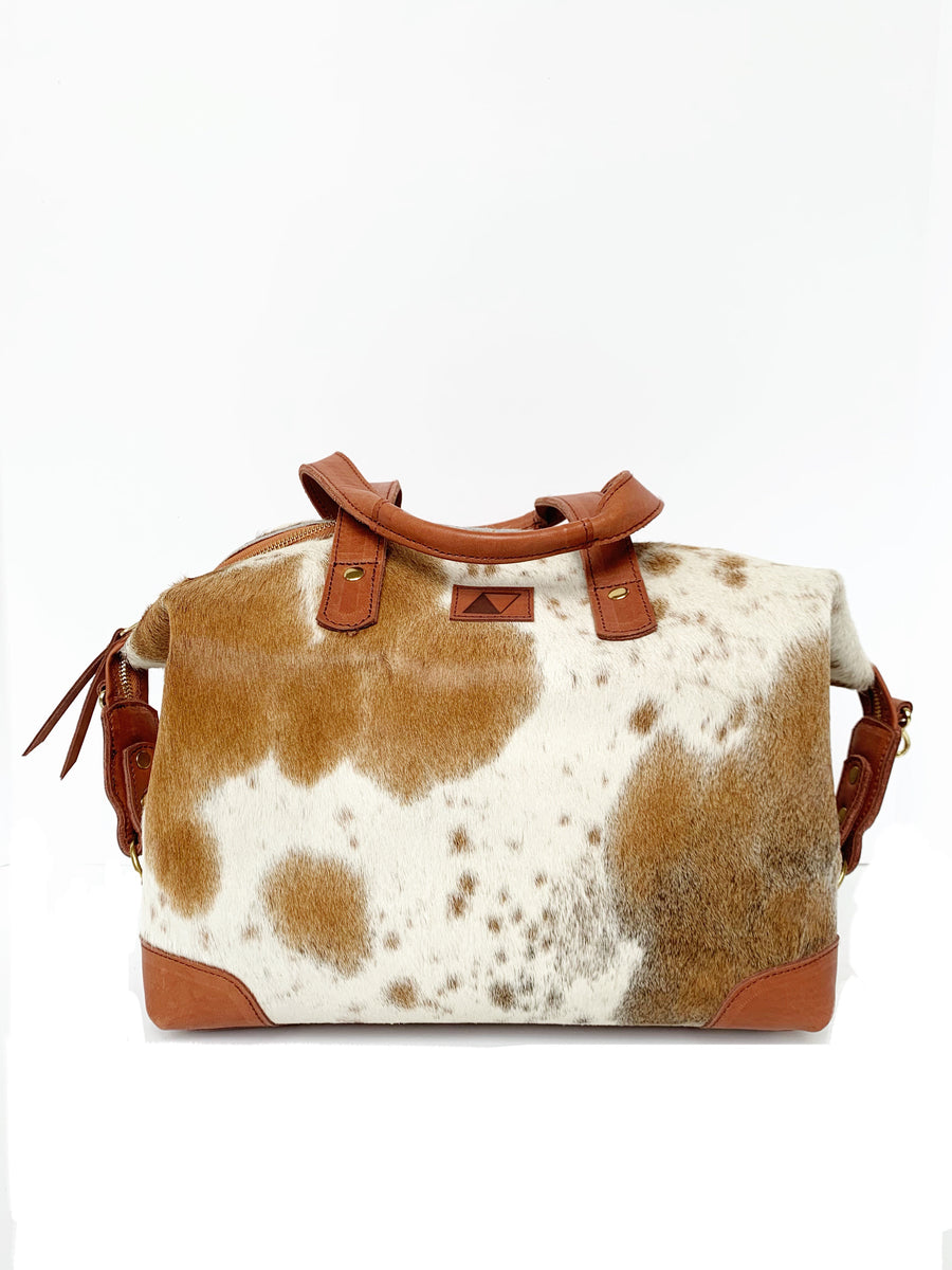 Leather cow hide handbag with crossbody strap