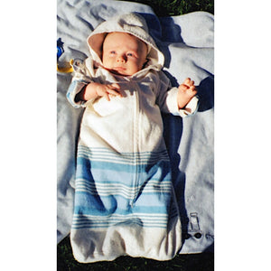 Baby in hooded flannel bunting bag.