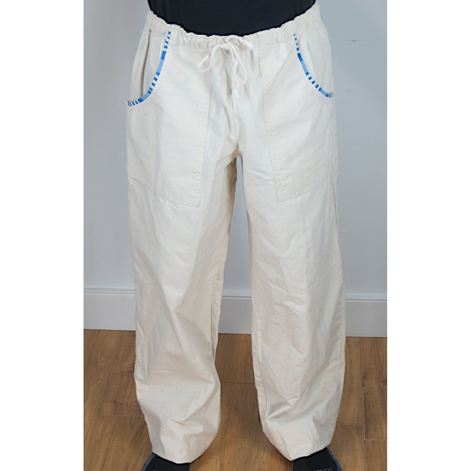 Natural colour flannel pajama pants with blue trim.