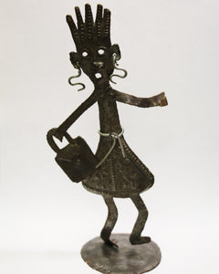 Standing Tin Person with Bag
