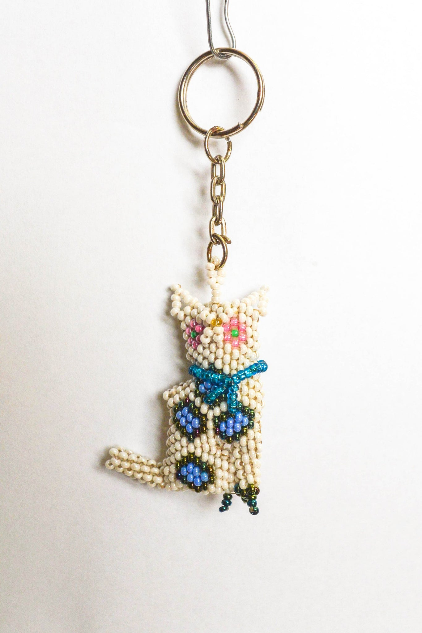 blue and white cat beaded keychain guatemala
