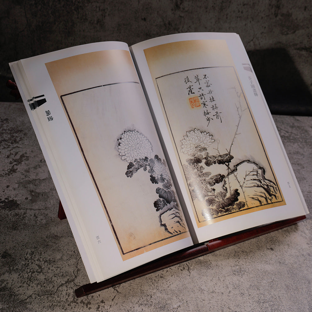 Learning Book for Traditional Chinese Sumi and Ink and Wash Painting opened and standing on a wooden foldable book stand
