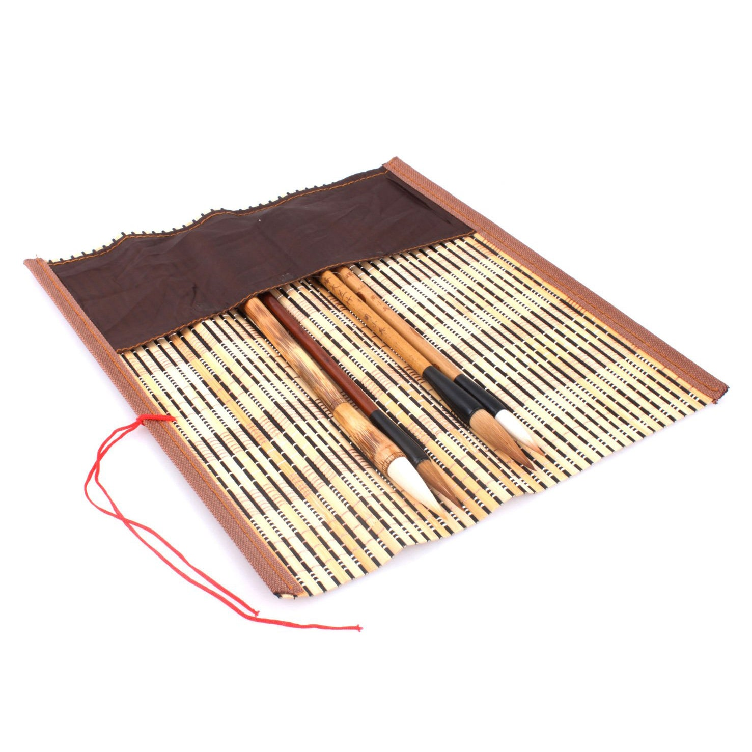 usage view of the bamboo brush wrap with pocket. This product is made of bamboo strips with a cloth pocket at one site where your brushes could be well positioned and protected inside