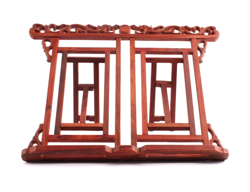 Foldable Chinese book stand for positioning sumi painting books and calligraphy learning material made of wood and hand carved with dragons