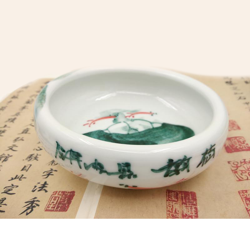 Oriental brush washer displaying the Twining Fish hand painted on the bottom and made of white Chinese ceramic used for calligraphy and sumi painting.