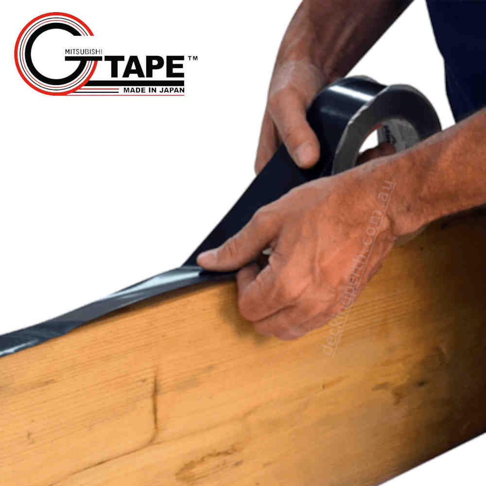 GTape 50mm Joist Protection Decking Tape. GT3404BK. Installing on a joist. Showing tradesmans hands.