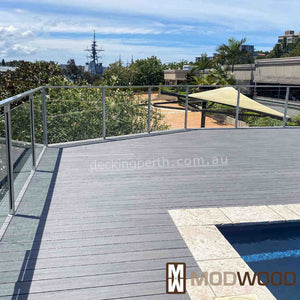 Modwood decking Magnetic Grey around a pool.