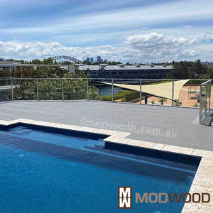 Modwood decking Magnetic Grey around a pool with the Sydney harbour bridge in the background