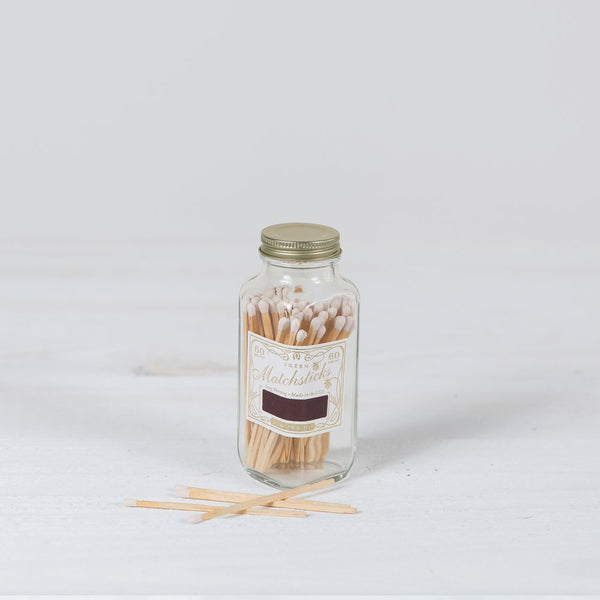 match bottle in white + gold
