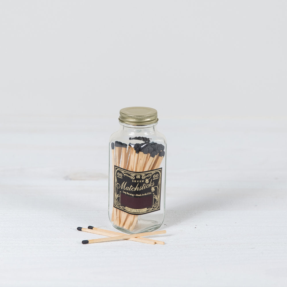 match bottle in black + gold