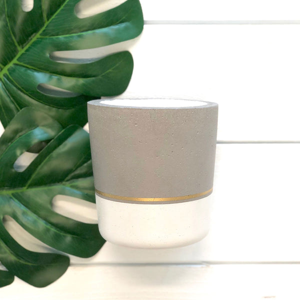 mangosteen candle in white + gold striped reusable concrete planter