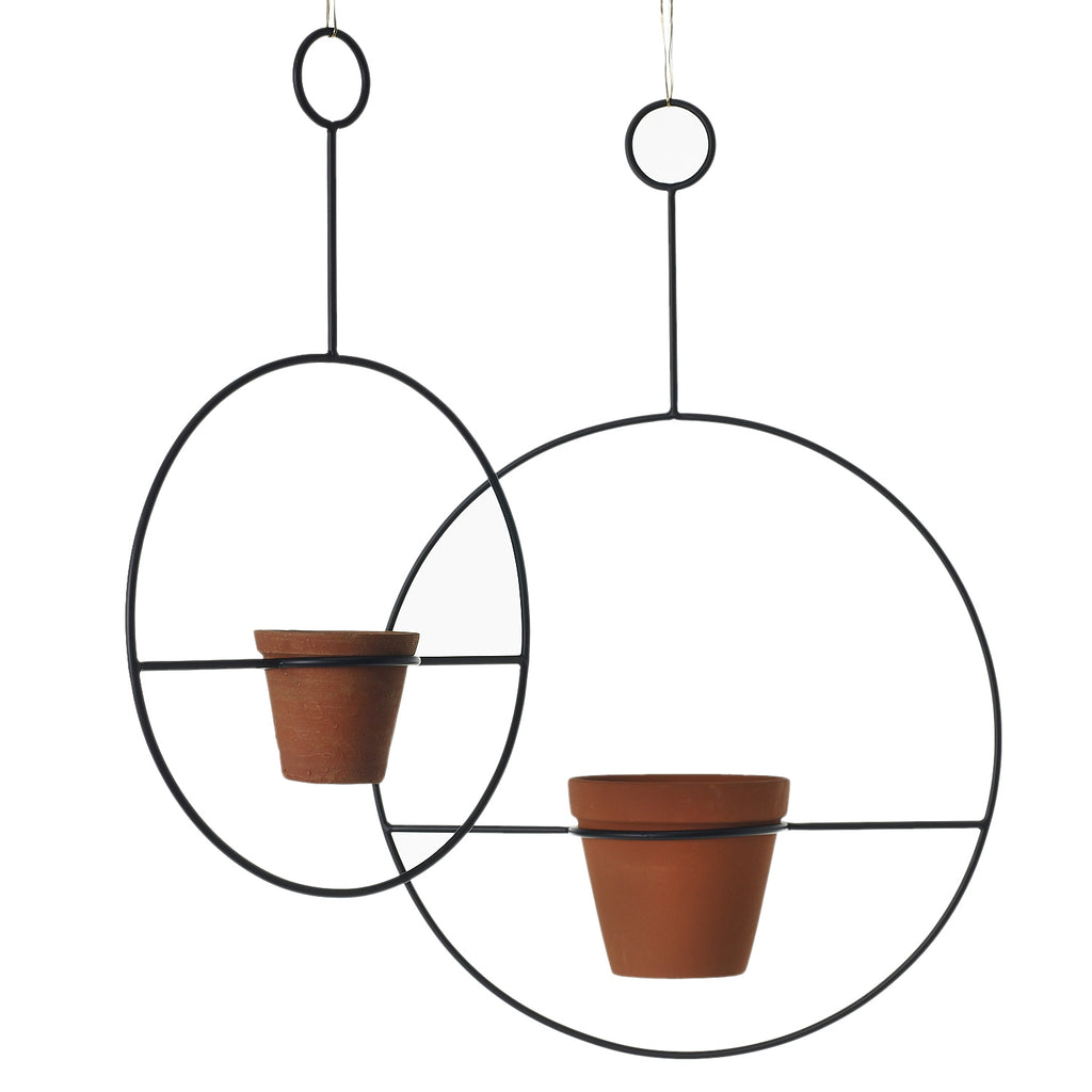 large round metal hanging planter with terracotta vase