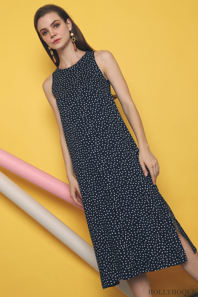 bff6602d68d A happy union of polka dotted prints on a midi cut complete with side  slits, end your week with a FriYAY in the Altis Polka Dotted Midi Dress.