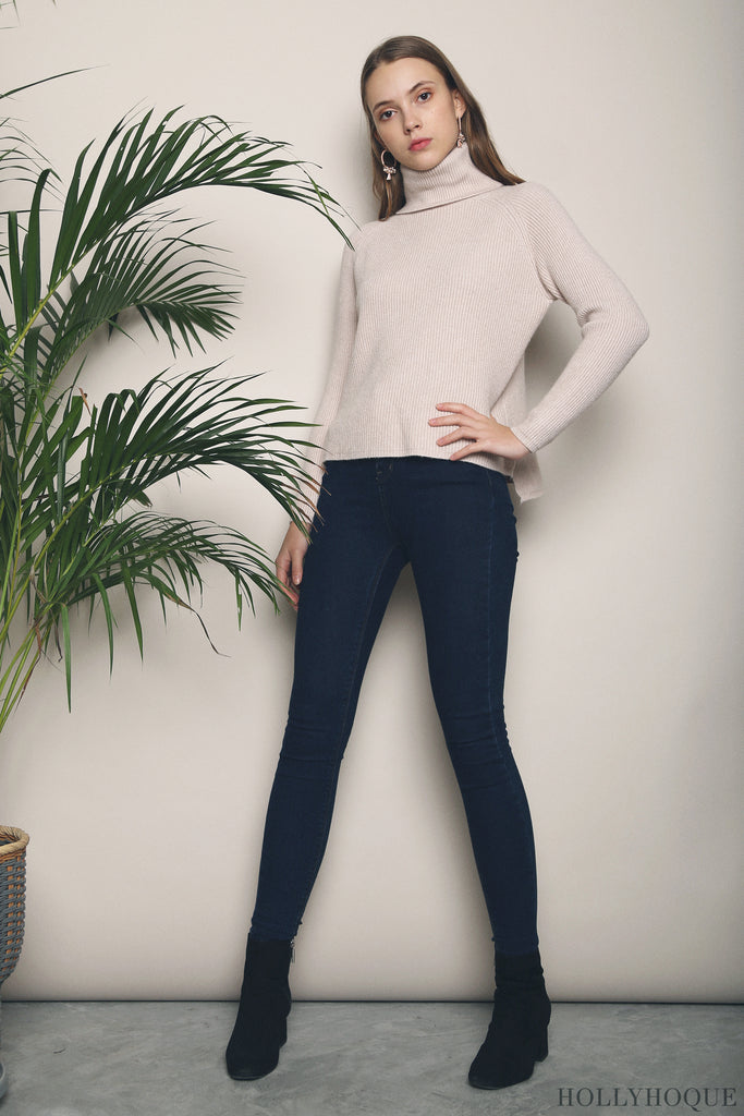 49fa8ff42f65b Crafted in a turtleneck design and hi-low hemline