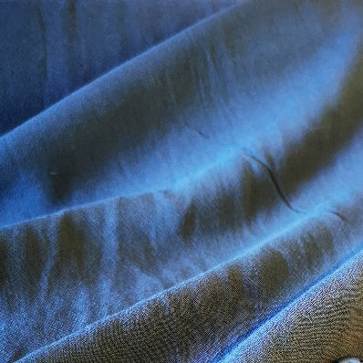 85%Viscose 15% linen blend in teal. Light weight and 127 wide.