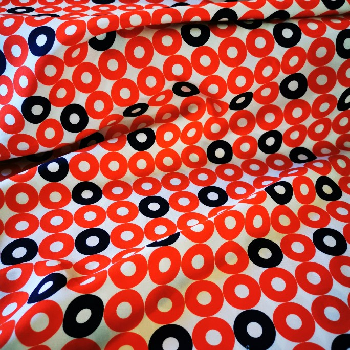 White Cotton and Steel rayon with Red circles and occasional navy circles. Made in Japan. Lightweight and 115cm wide.