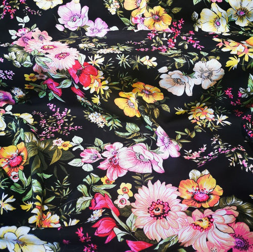Black floral rayon. Lightweight and floaty.