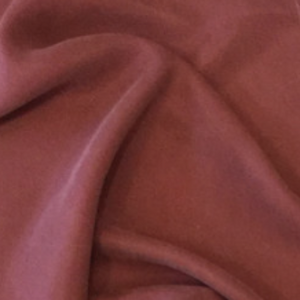 Warm brick rust brown cupro. Soft hand and drape, vegan silk.