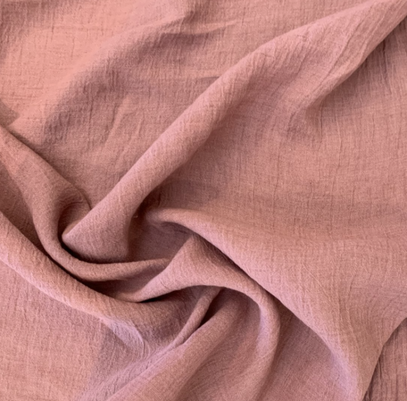100% linen with a high twist. Medium weight and crinkled. Soft blush pink colour.