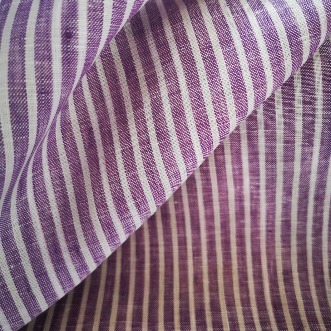 Lilac linen with fine white stripe. Lightweight and 150 wide.