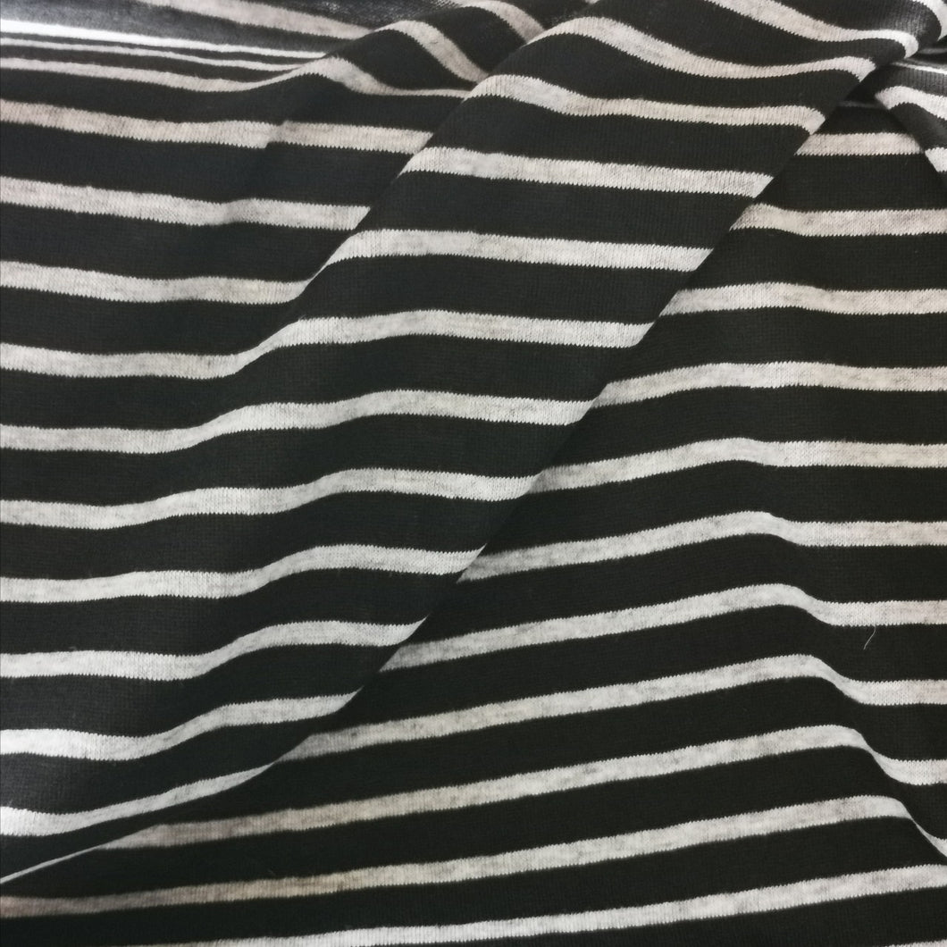Organic cotton jersey in black with grey stripe. Mid weight and 160cm wide. 150 gsm.