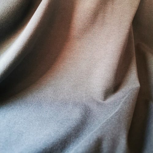 Organic cotton jersey in mushroom grey. Mid weight and 150cm wide. 150 gsm.
