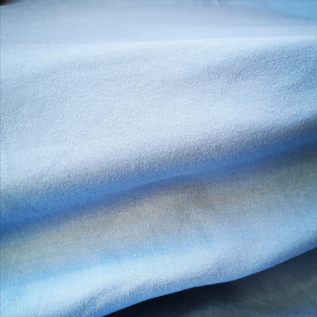 Fern organic cotton jersey in Blue. Mid weight and 150cm wide. 3% elastane.
