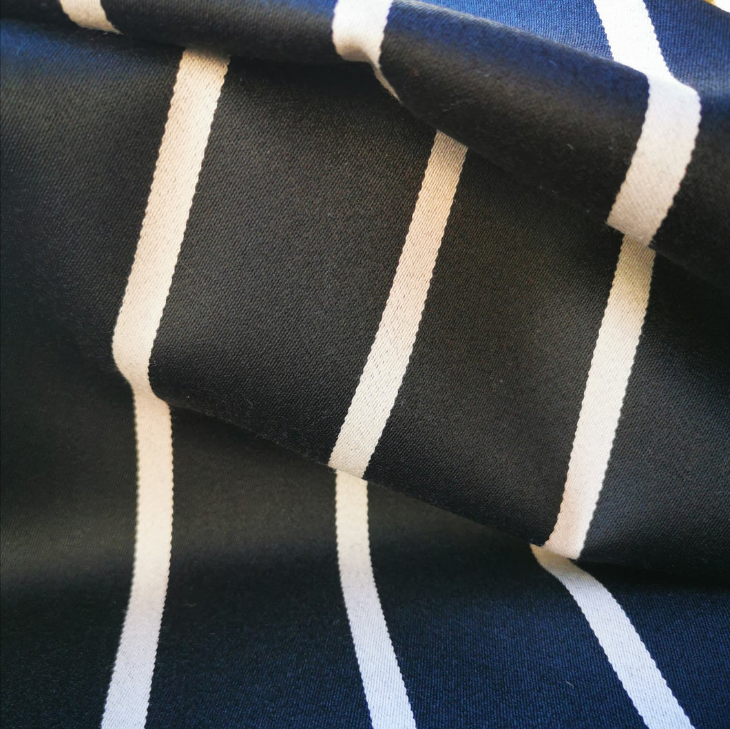 Black 100% wool suiting with cream 8mm stripe.