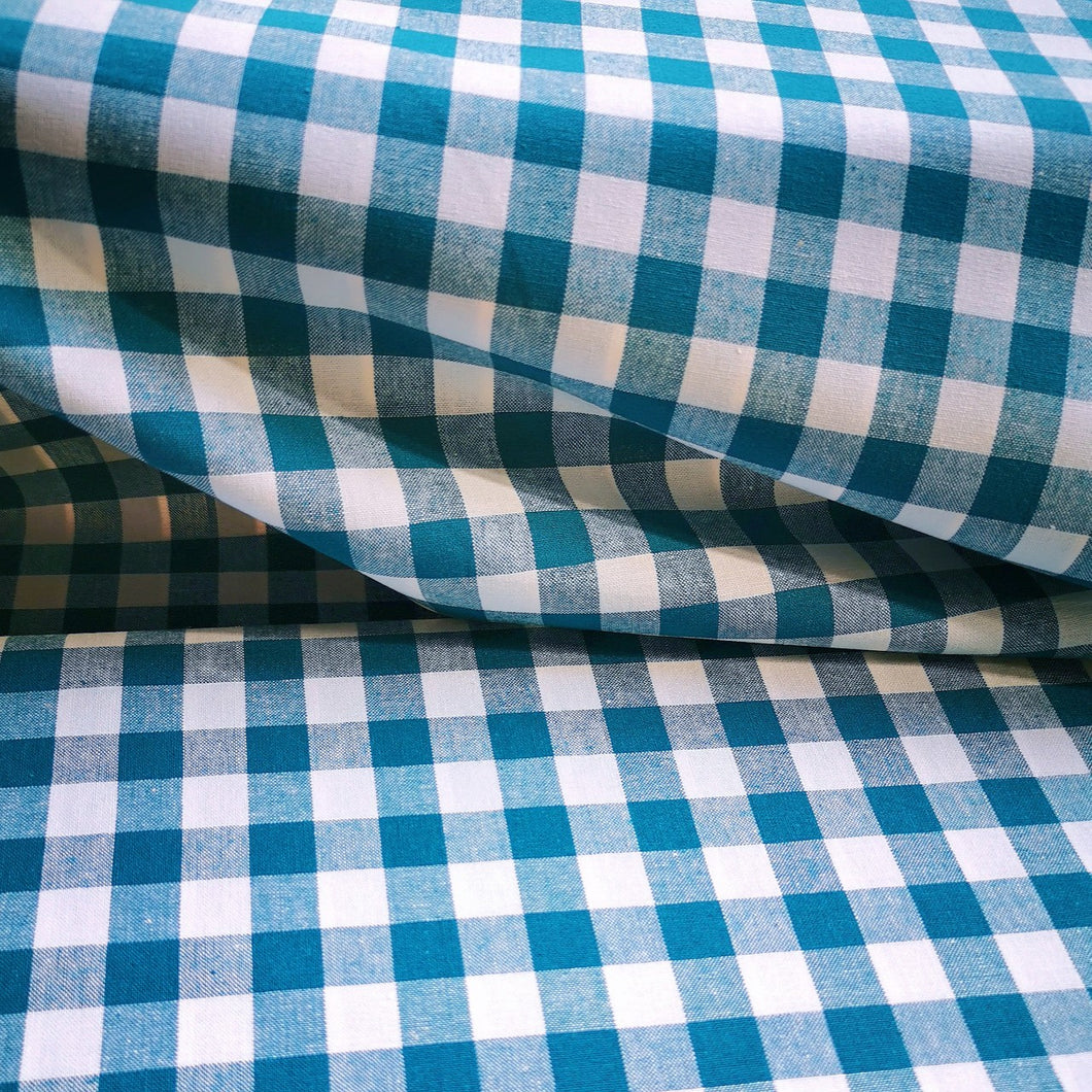 Cotton gingham in teal and white with 1cm square. Light to medium weight and 115cm wide.