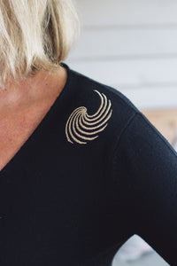 gold thread embroidery on black merino wool top
