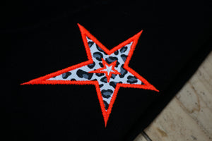 stretched neon animal print star