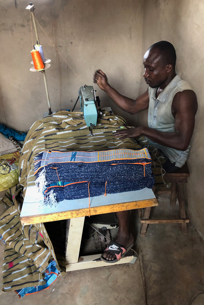 man sewing the woven fabrics together