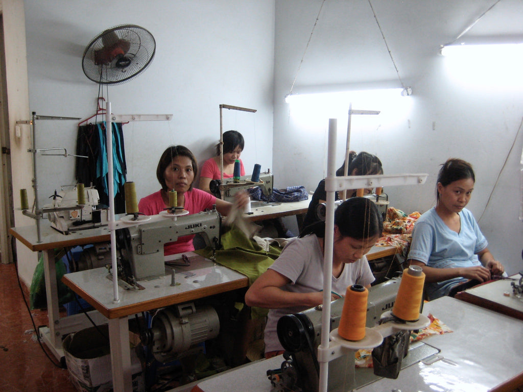 women sewing the collection to be sold in berlin